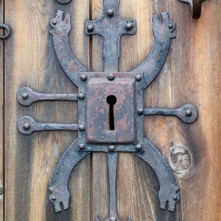 doorlock: Keyhole of old doorlock in a wooden door Stock Photo