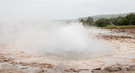 hydroxide: The famous Strokkur Geyser about to erupt - Iceland - Close-up Stock Photo