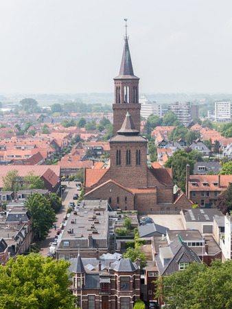 LEEUWARDEN, NETHERLANDS - MAY 28, 2016: View of a part of Leeuwarden with a big church on may 28, 2016.