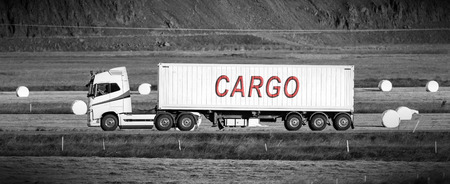 rural area: White trruck driving through a rural area - Cargo