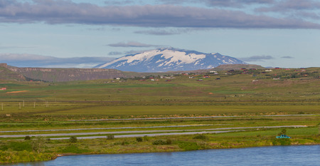 hekla: The volcano Hekla in Iceland shot in summer, old overrgrown lavafield in the foreground Stock Photo