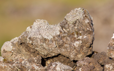 Lava rock from volcano as part of an old wall, Iceland Stock Photo