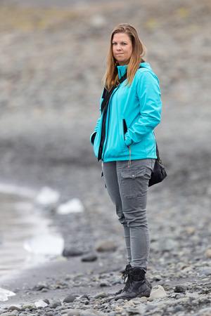 Woman walking over the beach at Jokulsarlon glacier lagoon in southern Iceland Stock Photo