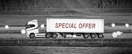 White trruck driving through a rural area - Special offer