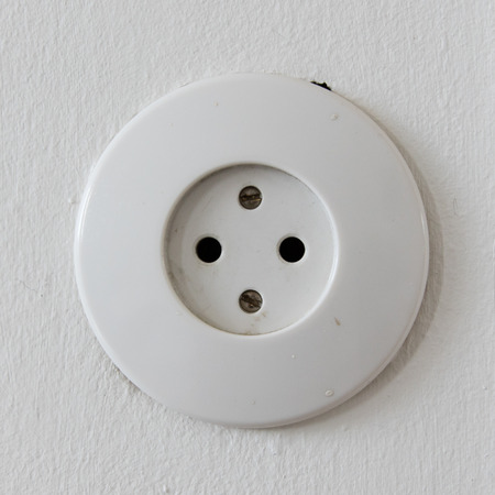grounded plug: White power outlet (electricity in Iceland), isolated