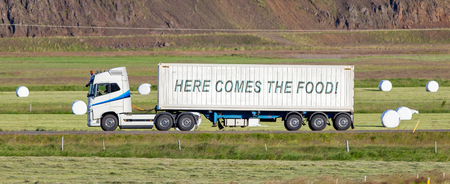White trruck driving through a rural area - Here comes the food Stock Photo