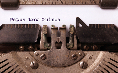 new guinea: Inscription made by vintage typewriter, country, Papua New Guinea Archivio Fotografico