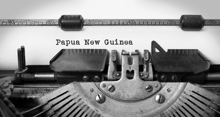 nuova guinea: Inscription made by vintage typewriter, country, Papua New Guinea Archivio Fotografico