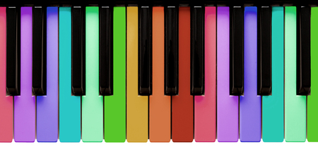 Rainbow piano keys, isolated on a white background
