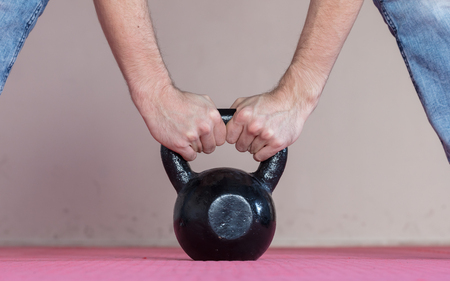 kettle bell: Black kettlebell ina gym - Selective focus