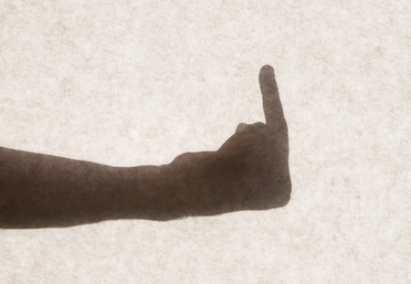 middlefinger: Silhouette behind a transparent paper - The finger