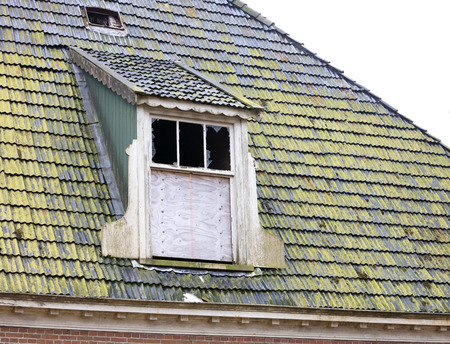 Broken roof of an abandoned farm in the Netherlands