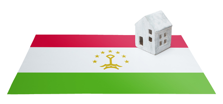 Small house on a flag - Living or migrating to Tajikistan