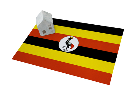 Small house on a flag - Living or migrating to Uganda