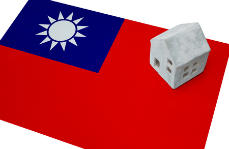 Small house on a flag - Living or migrating to Taiwan Stock Photo