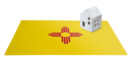 investment real state: Small house on a flag - Living or migrating to New Mexico