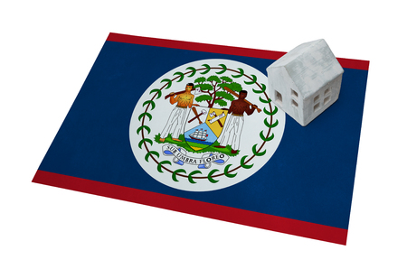 Small house on a flag - Living or migrating to Belize