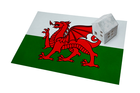 Small house on a flag - Living or migrating to Wales