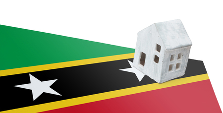 Small house on a flag - Living or migrating to Saint Kitts and Nevis Stock Photo