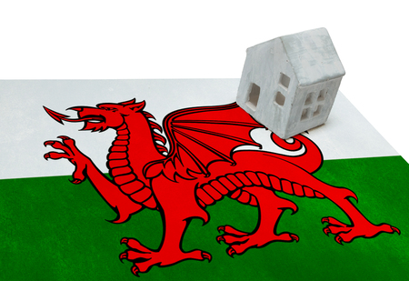 realestate: Small house on a flag - Living or migrating to Wales