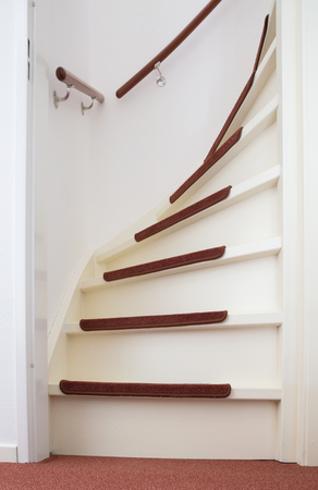 Stock Photo   White Wooden Stairs With Red Mats, Going Upstairs