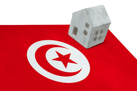 Small house on a flag - Living or migrating to Tunisia Stock Photo