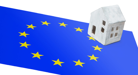 Small house on a flag - Living or migrating to the European Union Stock Photo