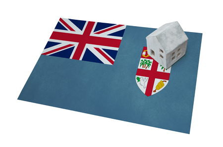 Small house on a flag - Living or migrating to Fiji