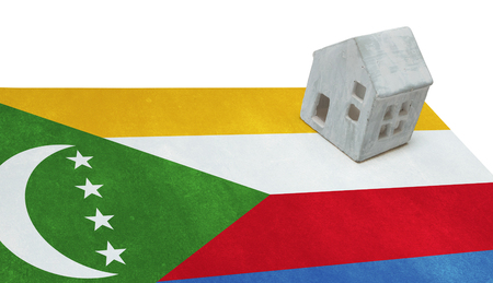 Small house on a flag - Living or migrating to Comoros Stock Photo
