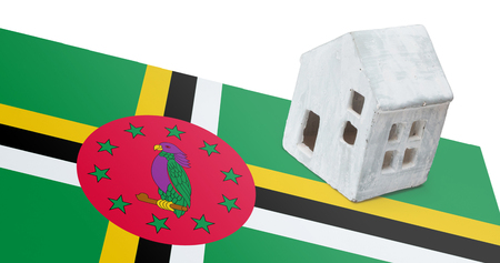 Small house on a flag - Living or migrating to Dominica