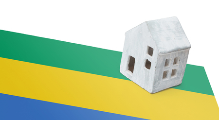 Small house on a flag - Living or migrating to Gabon Stock Photo