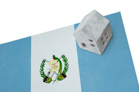 Small house on a flag - Living or migrating to Guatemala Stock Photo