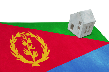 Small house on a flag - Living or migrating to Eritrea Stock Photo