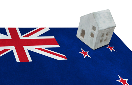 Small house on a flag - Living or migrating to New Zealand Stock Photo