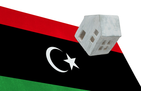 lybia: Small house on a flag - Living or migrating to Libya
