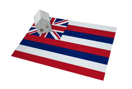 Small house on a flag - Living or migrating to Hawaii