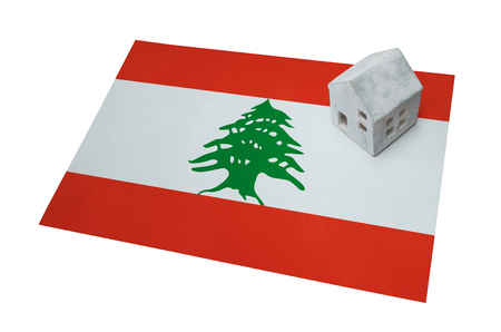 migrating: Small house on a flag - Living or migrating to Lebanon