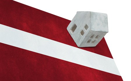 migrating: Small house on a flag - Living or migrating to Latvia