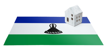 migrating: Small house on a flag - Living or migrating to Lesotho