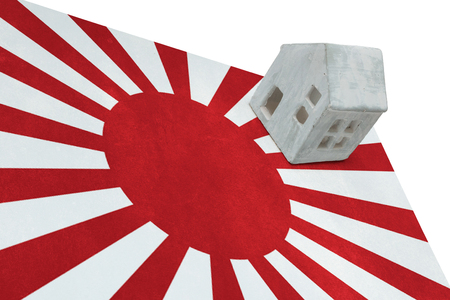 migrating: Small house on a flag - Living or migrating to Japan Stock Photo