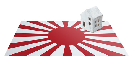 Small house on a flag - Living or migrating to Japan Stock Photo