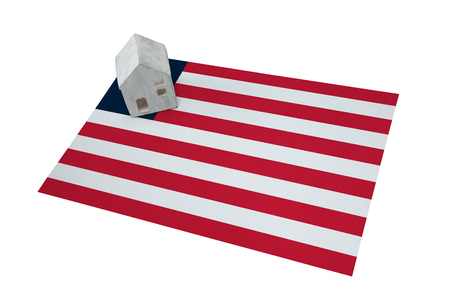 Small house on a flag - Living or migrating to Liberia Stock Photo