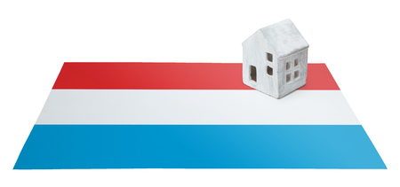 Small house on a flag - Living or migrating to Luxembourg Stock Photo
