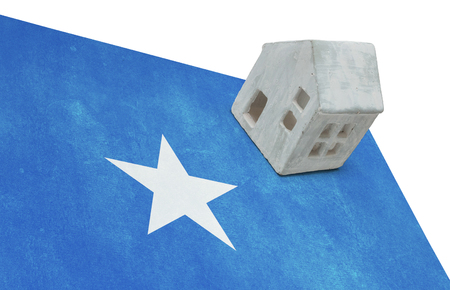 realestate: Small house on a flag - Living or migrating to Somalia