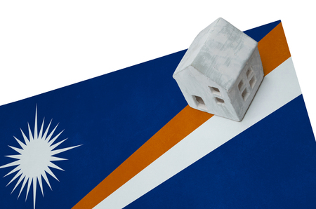 Small house on a flag - Living or migrating to Marshall Islands