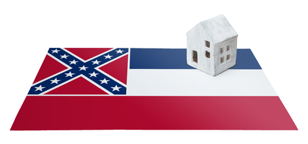 Small house on a flag - Living or migrating to Mississippi