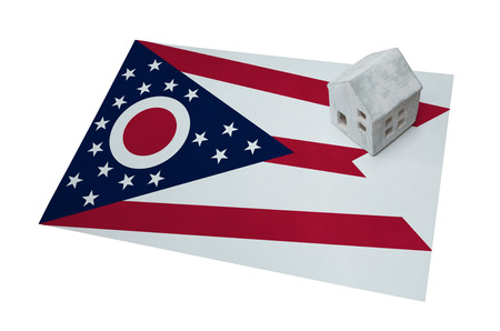 realestate: Small house on a flag - Living or migrating to Ohio