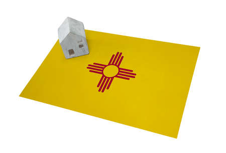 Small house on a flag - Living or migrating to New Mexico