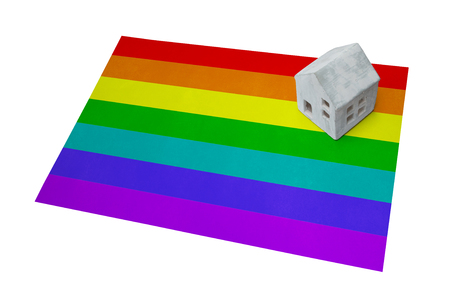 Small house on flag - Rainbow flag Stock Photo
