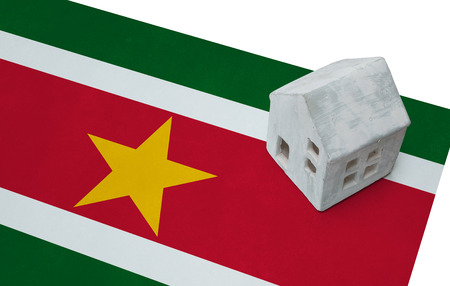 Small house on a flag - Living or migrating to Suriname Stock Photo